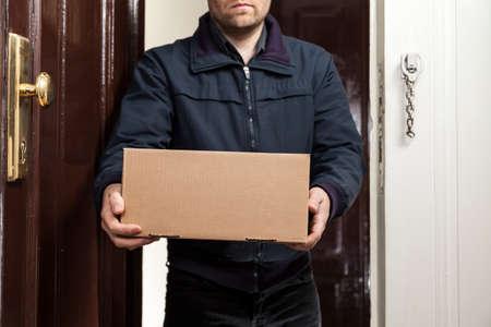 delivers: Postman delivers parcel