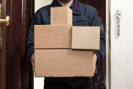 Postman brings a lot packages Stock Photo