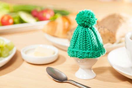 cosy: Egg cosy on breakfast table Stock Photo