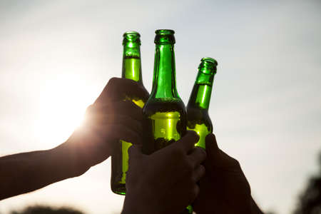 Make a toast with beer bottles