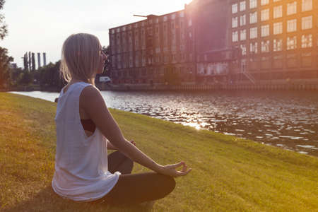 sittting: Woman doing yoga in Berlin