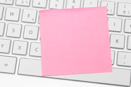 adhesive: Pink adhesive note keyboard Stock Photo