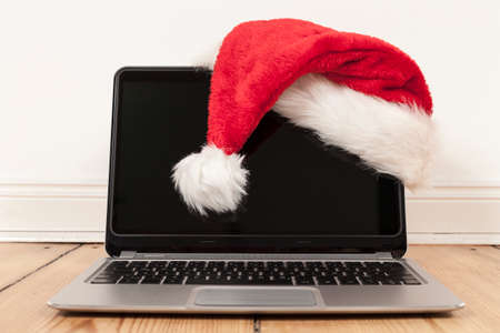 netbooks: laptop and santa claus cap Stock Photo