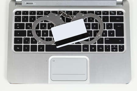 cheater: credit card cheater with handcuff on laptop