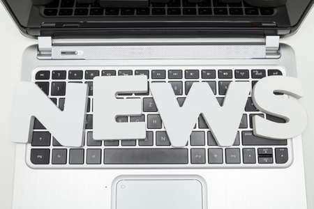 lates: news letters on keyboard of laptop