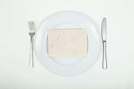 whitespace: Blank card on plate Stock Photo