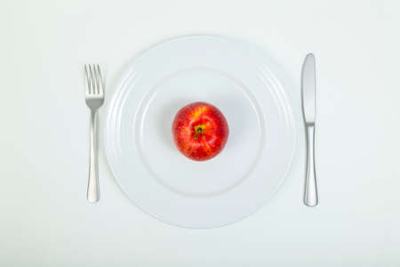 perfectionist: Red apple on plate Stock Photo