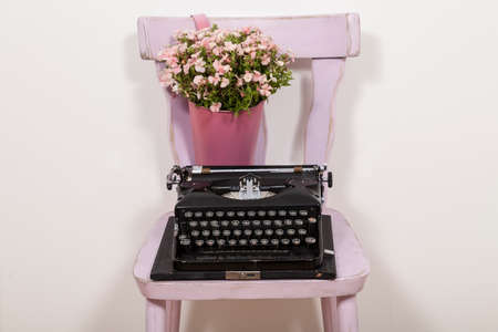 the outmoded: Typewriter on chair