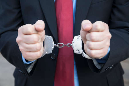 manacle: Businessman in handcuffs Stock Photo