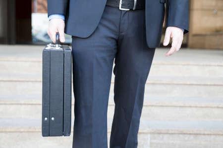 attache case: Businessman with briefcase