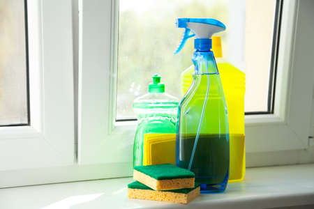 window bench: Cleaning agent on window sill Stock Photo