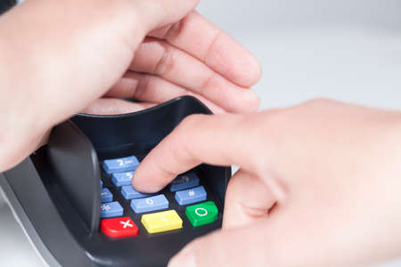 pin code: Entering a PIN Code in a card reader (payment) Stock Photo