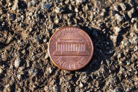 penny: Luck penny on asphalt (one Dollar cent)