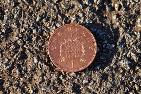 penny: Lucky penny on asphalt (british pound)