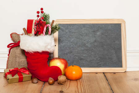 Santa boots and blackboard