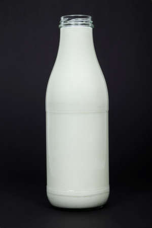 pasteurized: Bottle of milk on black background