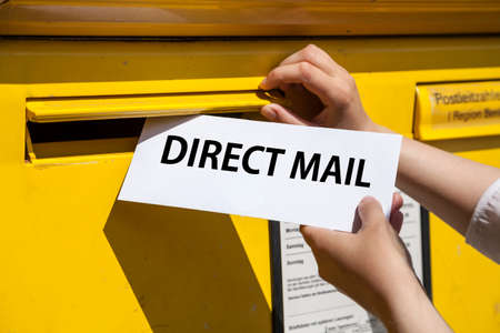 direct mail: direct mail letter into mailbox