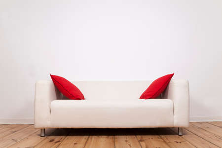 red pillows: Sofa with red pillows and space on wall Stock Photo