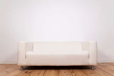 whitespace: Sofa at a wall in an room