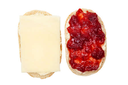 Bread roll with cheese and jam Stock Photo