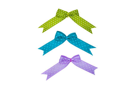 Ribbons in different colors on white