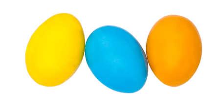 Stacked easter eggs on white Standard-Bild