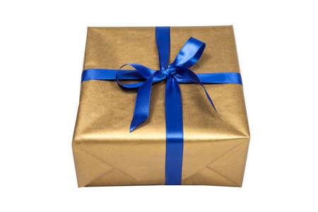 Golden christmas present with blue ribbon on white Standard-Bild