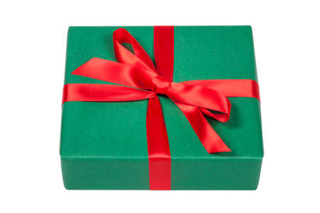 Green gift box with red ribbon on white