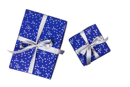 Blue christmas present with silver stars on white (top view)
