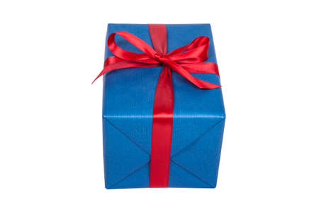 Blue christmas present with red ribbon on white Standard-Bild