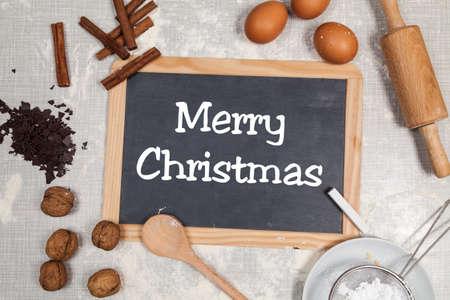 Merry christmas written on blackboard