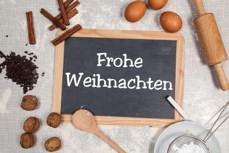 Merry christmas (written in german) written on blackboard