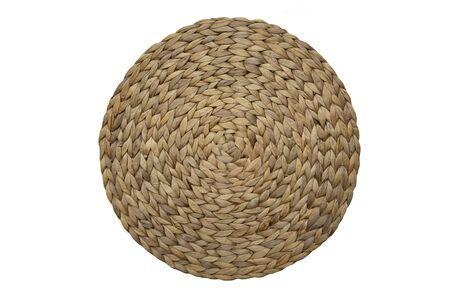 Round woven straw mat isolated