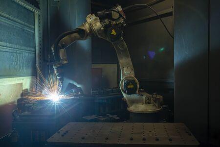 robots welding in a car