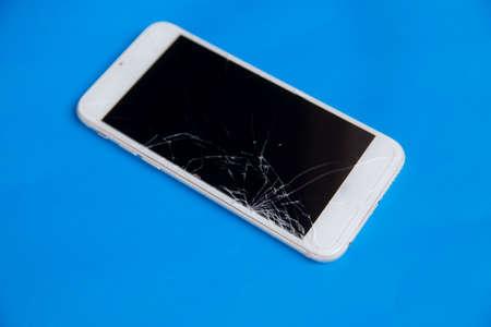 Broken mobile phone. Cracked smartphone screen