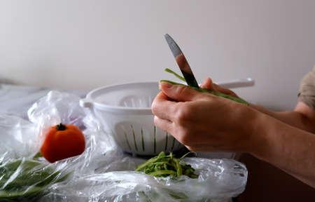Woman cutting Green beans. close up