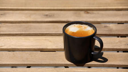 coffee cup on wooden table, top view
