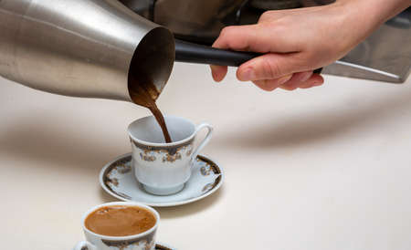 woman Pouring turkish coffee, front view