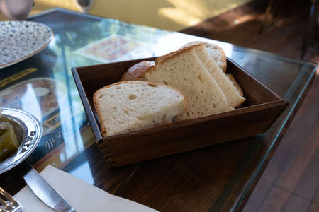 front view of bread in wooden bowl on table
