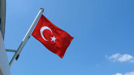 Turkish flag on cloudy sky background