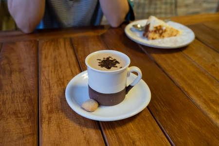 white coffee mug on wooden table Фото со стока