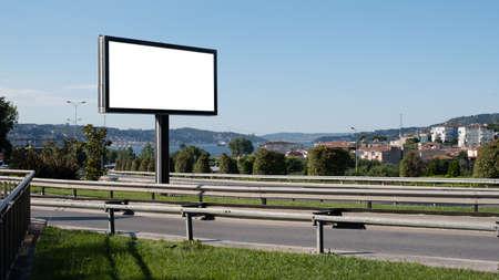 blank billboard by the roadside, mock up Фото со стока