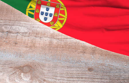 Flag Portugal and space for text on a wooden background Foto de archivo