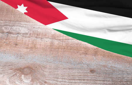 Flag Jordan and space for text on a wooden background 写真素材