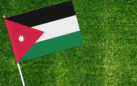 Close-up of Jordan flag against closed up view of grass