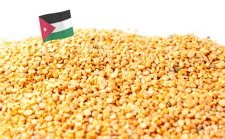 Jordan flag sticking in a bunch of peas. The concept of export and import of peas