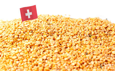 Switzerland flag sticking in a bunch of peas. The concept of export and import of peas