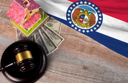 Property auction, flag Missouri, gavel wooden and model house on wooden background, lawyer of home real estate