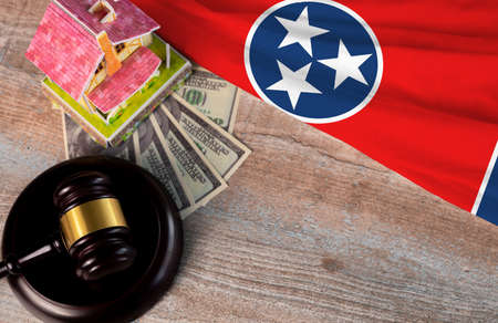 Property auction, flag Tennessee, gavel wooden and model house on wooden background, lawyer of home real estate
