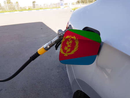 Flag of Eritrea on the car's fuel tank filler flap. Petrol station. Fueling car at a gas station.